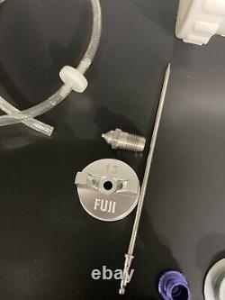 Fuji T75G hvlp turbine spray gun with three air caps, needles, and nozzles